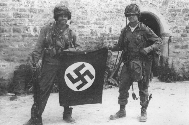 23 Dec 1920 birthday of Easy Company veteran John Lee Eubanks. John can be seen holding the flag with Walter Gordon..jpg