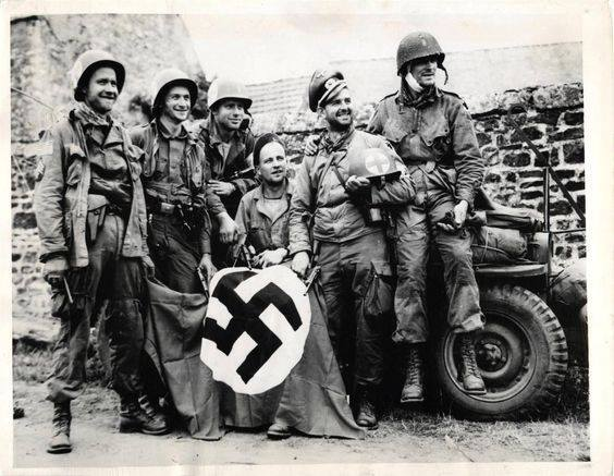 1944 - 3rd Battalion, 508th PIR, 82nd Abn Div medics, captured during D-Day invasion, display their souvenirs after being liberated by comrades in Orglandes, France..jpg