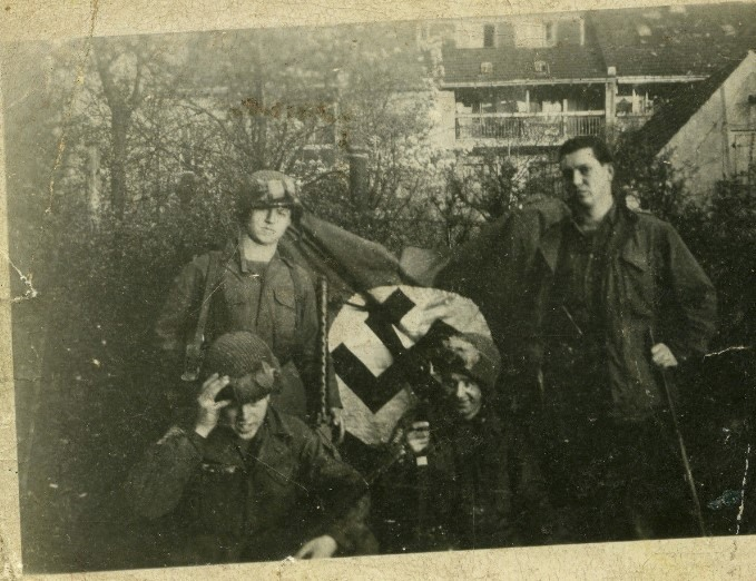 Paratroopers show off their captured German flag..jpg